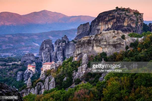 hanging on cliffs -meteora greece at sunrise () - thessaly stock pictures, royalty-free photos & images