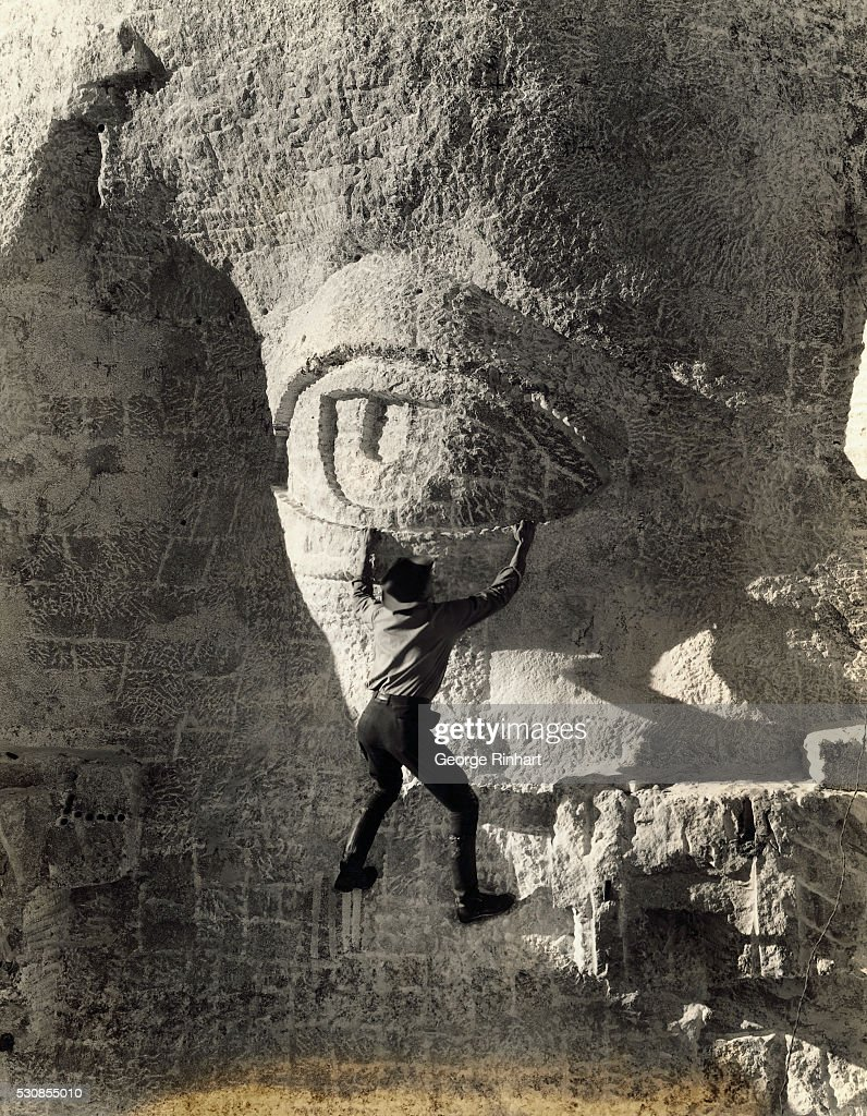 Worker Hanging on to Eyelid at Mt Rushmore : News Photo