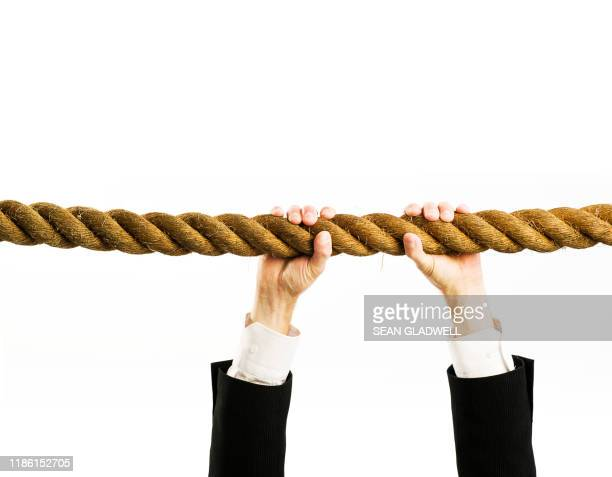 hanging on to rope - a helping hand stock pictures, royalty-free photos & images