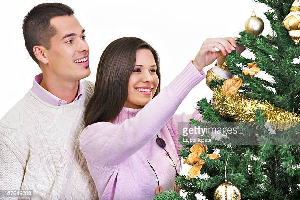 Hanging ornaments on a christmas tree