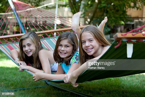 hanging out - barefoot feet up lying down girl stock photos and pictures