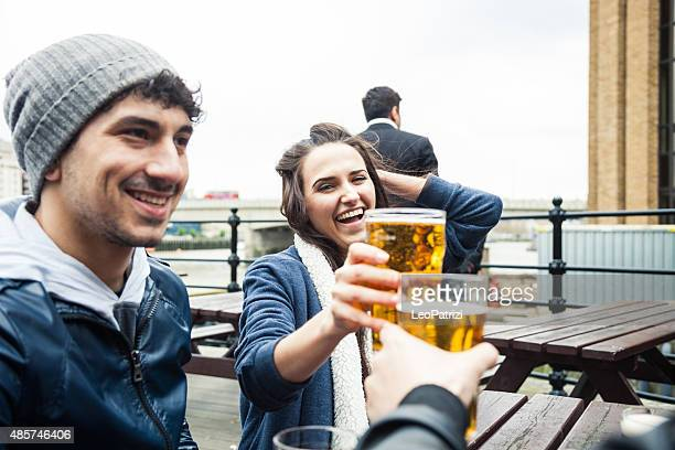 hanging out with a fresh beer in a london pub - beer stein stock photos and pictures