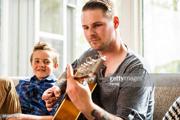Hanging out with dad playing guitar.