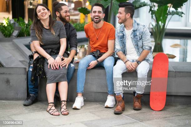 hanging out with real friends - heterosexual couple stock pictures, royalty-free photos & images