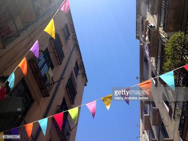 Hanging pennants in a Barcelona street