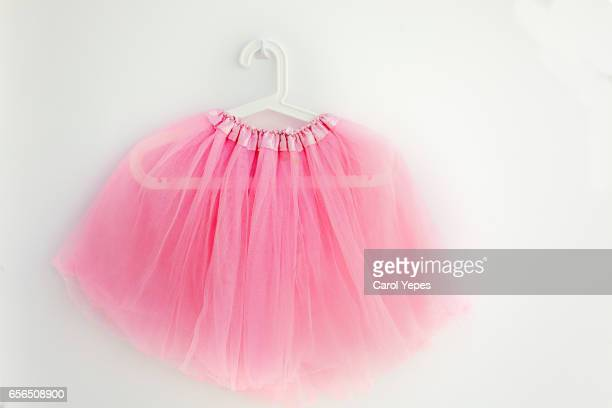 hanging pink tutu - pink dress stock pictures, royalty-free photos & images