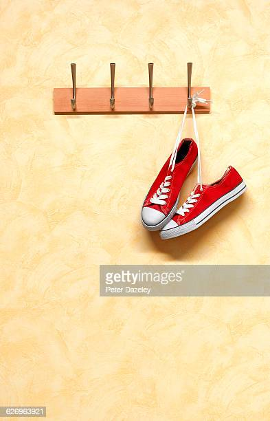 Hanging red trainers with copy space
