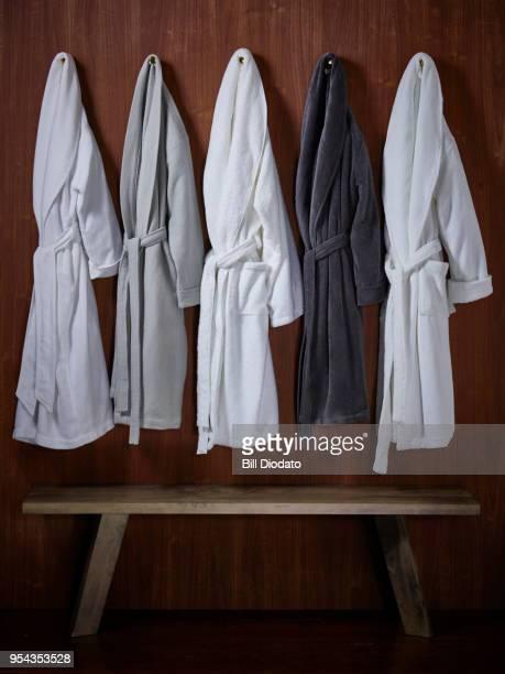 5 hanging robes - sauna stock-fotos und bilder