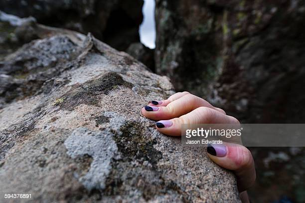 painted fingernails of a person climbing through rock formations. - mamelon photos stock pictures, royalty-free photos & images