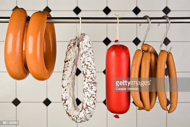 hanging sausages - salumeria stock photos and pictures