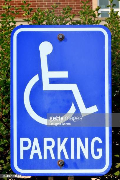 hanging sign that advises of handicap parking area - disabled sign stock photos and pictures