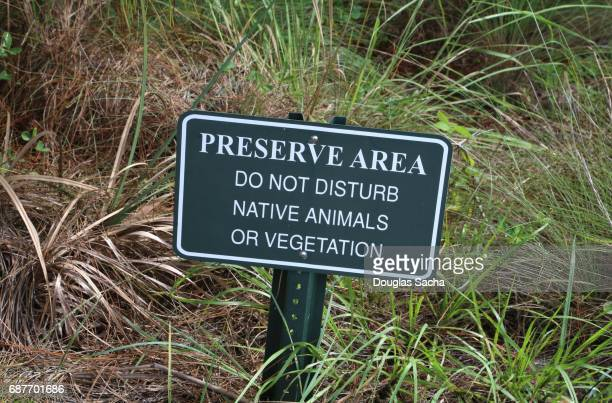 Hanging sign that advises of wildlife protection area