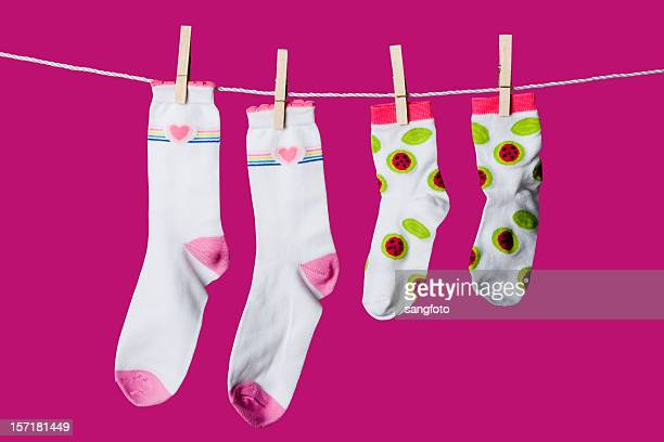 hanging socks - clip stock pictures, royalty-free photos & images