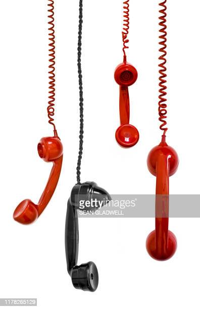 hanging telephone receivers - telephone stock pictures, royalty-free photos & images