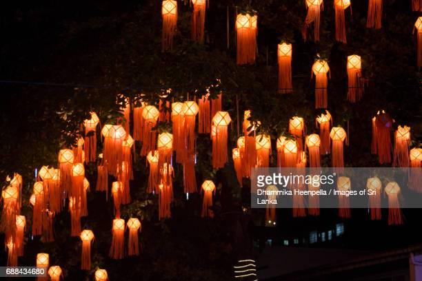 hanging vesak lanterns at night - buddha's birthday stock pictures, royalty-free photos & images