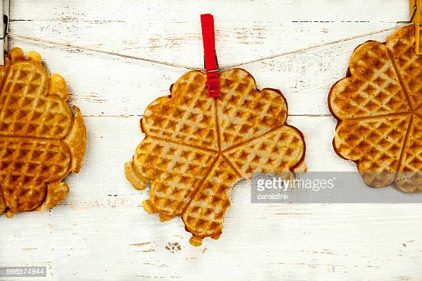 hanging waffles - carolafink stock pictures, royalty-free photos & images