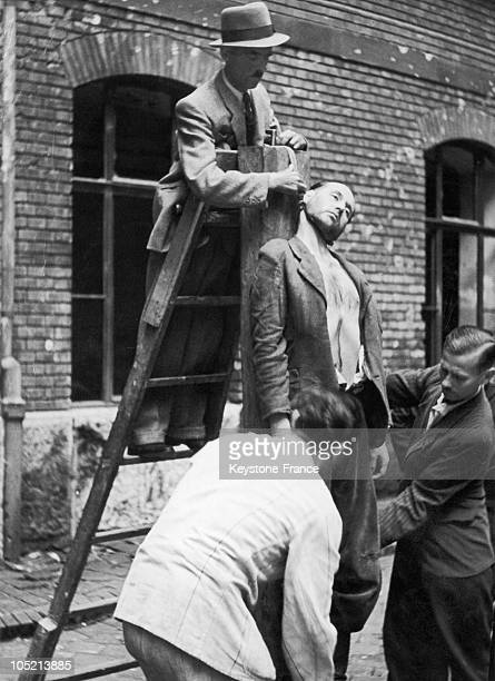 Hangman Bogar Detaching The Body Of One Of The Leaders Of The ArrowCross Hungarian Fascist Party After His Execution By Hanging In 1946