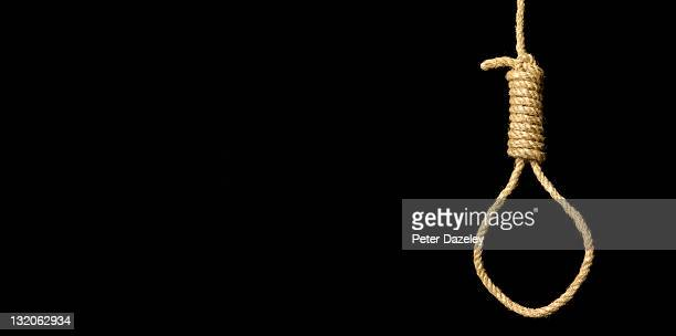 hangman's noose on black background - hanging stock pictures, royalty-free photos & images