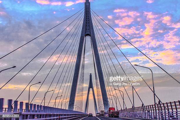 hangzhou bay bridge against cloudy sky during sunset - hangzhou stock photos and pictures