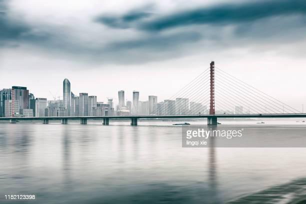hangzhou, china, qianjiang new town skyline in heavy fog - china east asia foto e immagini stock