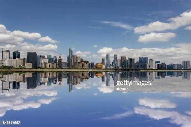 hangzhou city skyline and qiantang river,china - reflection lake stock photos and pictures
