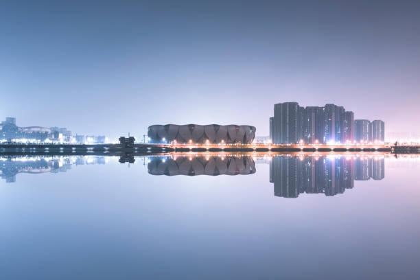 Hangzhou Olympic Sports Center against city skyline,Hangzhou