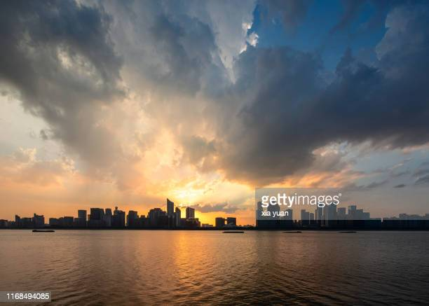 hangzhou skyline at dusk,china - moody sky stock pictures, royalty-free photos & images