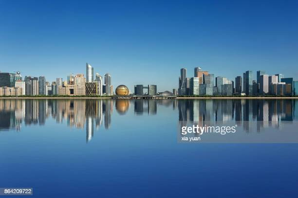 hangzhou skyline,china - reflection lake stock photos and pictures