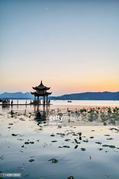 hangzhou west lake jixian pavilion in the sunset - west lake hangzhou stock pictures, royalty-free photos & images
