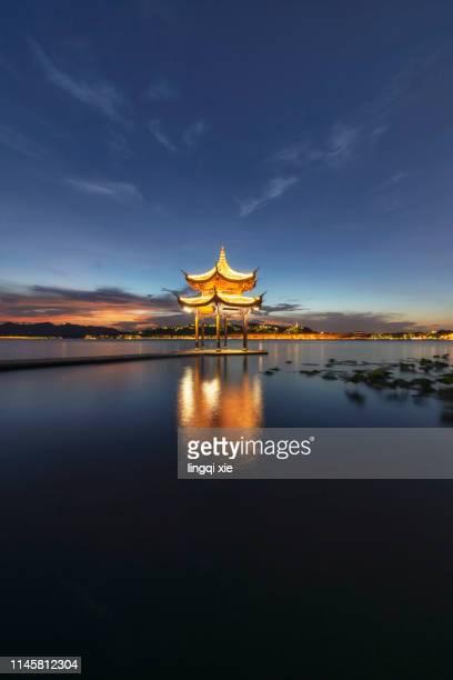 hangzhou west lake jixian pavilion sunset scenery - パビリオン ストックフォトと画像
