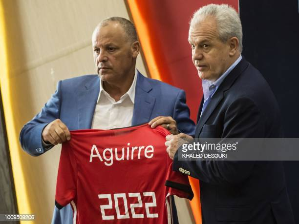 Hani Abu Rida president of the Egyptian Football Association and Mexico's Javier Aguirre hold the jersey of Egypts national team during a press...