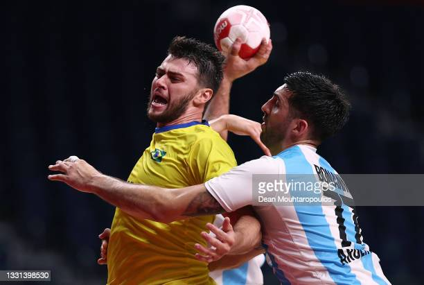 Haniel Langaro of Team Brazil attempts to shoot at goal whilst being challenged by Nicolas Bonanno of Team Argentina during the Men's Preliminary...