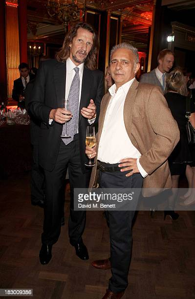 Hanif Kureishi and guest attend the launch of Geordie Greig's new book Breakfast With Lucian on October 3 2013 in London England