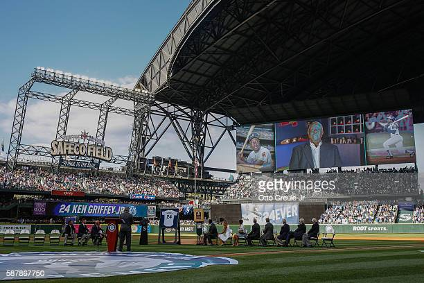 Hank Aaron appears on the scoreboard in a video tribute to Ken Griffey Jr during a jersey retirement ceremony prior to the game between the Seattle...