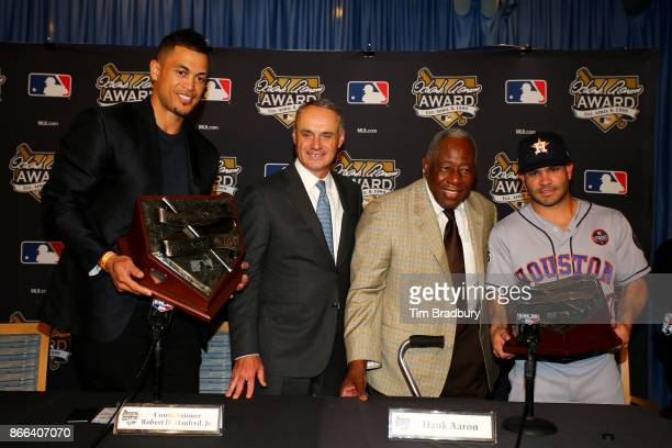 2017 Hank Aaron Award recipient Giancarlo Stanton of the Miami Marlins Major League Baseball Commissioner Robert D Manfred Jr Baseball Hall of Famer...