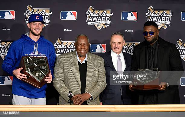 Hank Aaron Award recipients Kris Bryant of the Chicago Cubs and David Ortiz of the Boston Red Sox pose for a photo with Hall of Famer Hank Aaron and...