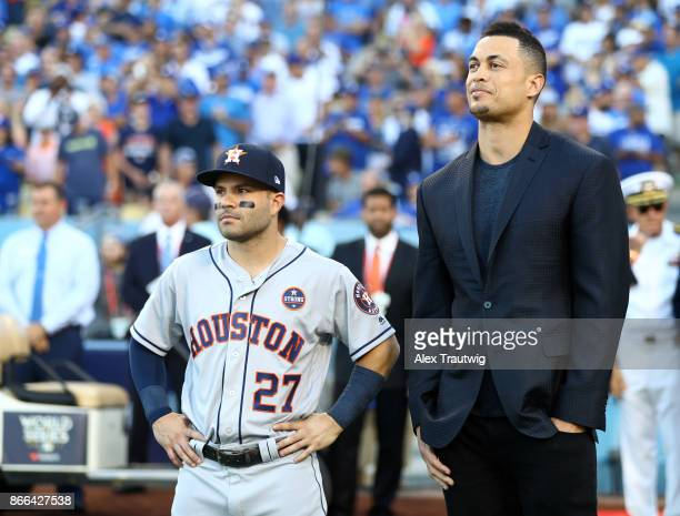 Hank Aaron Award winners Jose Altuve of the Houston Astros and Giancarlo Stanton of the Miami Marlins are seen on field before Game 2 of the 2017...