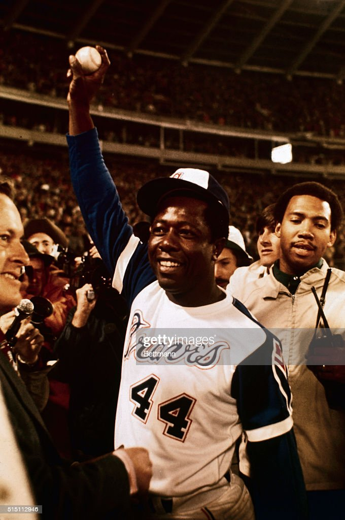 Hank Aaron Holding Baseball Hit for 715th Home Run : News Photo