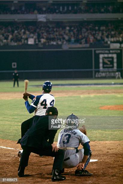 Hank Aaron of the Atlanta Braves hits his 715th career home run breaking Babe Ruth's long standing record at Atlanta-Fulton County Stadium on April...