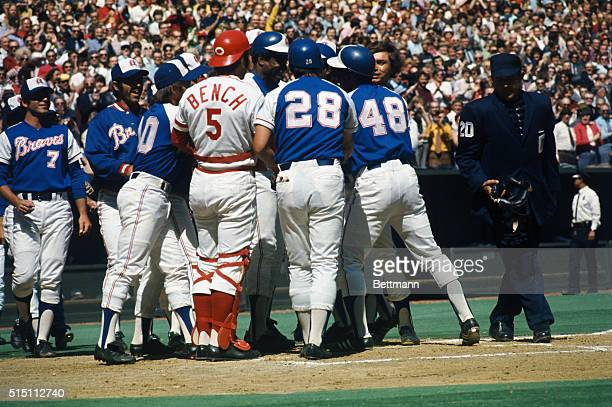 Hank Aaron of the Atlanta Braves is surrounded here by members of his own team as well as by Reds after hitting his 713th home run to tie Babe Ruth's...