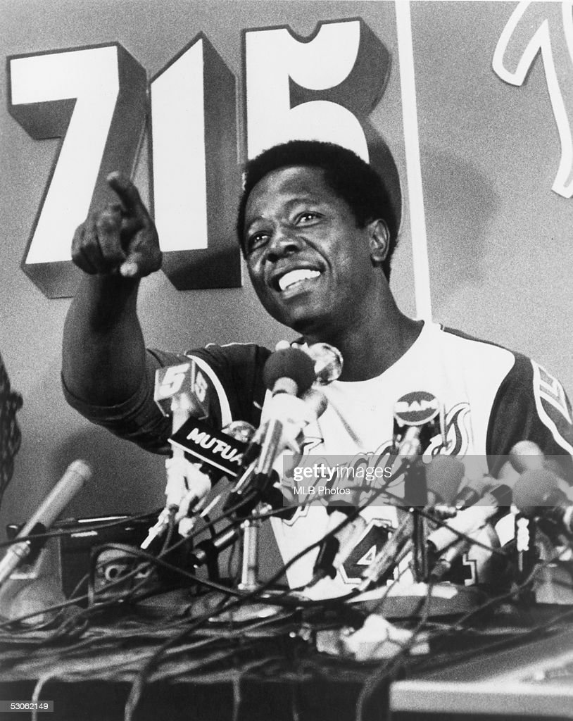 Hank Aaron #44 of the Atlanta Braves talks during a press conference after he hit his 715th career home run on April 8, 1974 against the Los Angeles Dodgers.