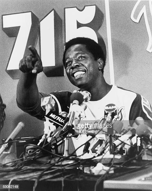 Hank Aaron of the Atlanta Braves talks during a press conference after he hit his 715th career home run on April 8 1974 against the Los Angeles...
