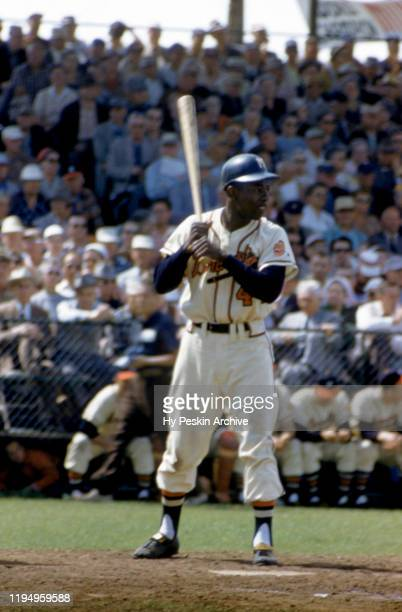 Hank Aaron of the Milwaukee Braves bats during an MLB Spring Training game against the New York Yankees circa March 1958 in Bradenton Florida