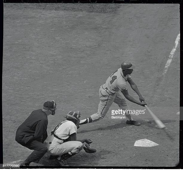 Hank Aaron of the Milwaukee Braves is shown hitting his 37th home run of the season in the 4th inning of the game against the Brooklyn Dodgers at...