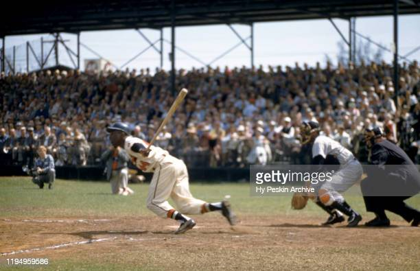 Hank Aaron of the Milwaukee Braves swings at the pitch during an MLB Spring Training game against the New York Yankees circa March 1958 in Bradenton...