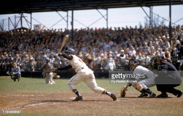 Hank Aaron of the Milwaukee Braves swings at the pitch during an MLB Spring Training game against the New York Yankees circa March, 1958 in...