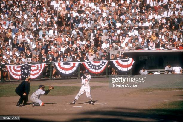 Hank Aaron of the Milwaukee Braves takes the pitch inside as catcher Yogi Berra of the New York Yankees makes the catch during Game 5 of the 1957...