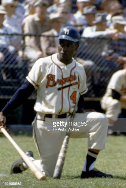Hank Aaron of the Milwaukee Braves waits on ondeck during an MLB Spring Training game against the New York Yankees circa March 1958 in Bradenton...