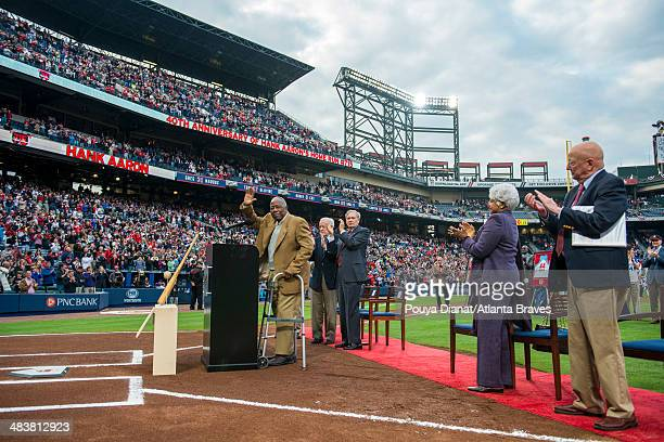 Hank Aaron speaks during a ceremony honoring his 715th home run before the game between the Atlanta Braves and the New York Mets at Turner Field on...