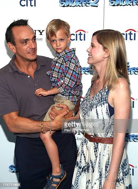 Hank Azaria Hal Azaria and Katie Wright attend The Smurfs 2 New York Blue Carpet Screening at Lighthouse International Theater on July 28 2013 in New...